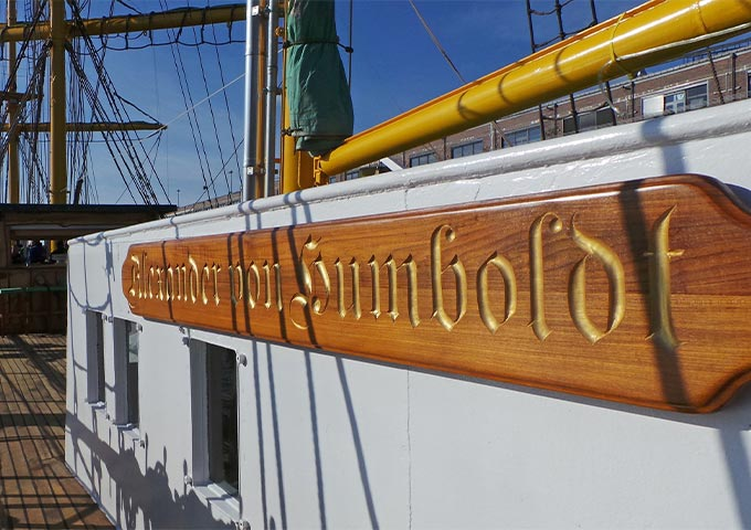 """View of the upper deck of the """"Alexander von Humboldt"""". The boat lettering shines in the sun."""